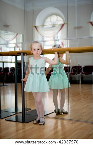 The girl in a dance hall before an exit
