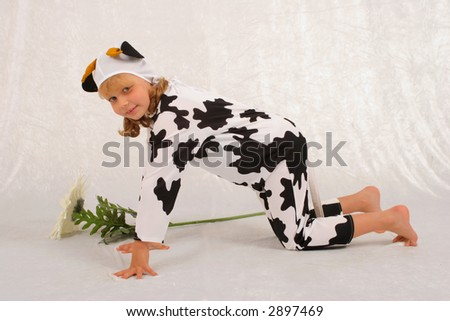 The girl in a fancy dress of the cow