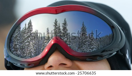 The girl in a mask for snowboarding, close up
