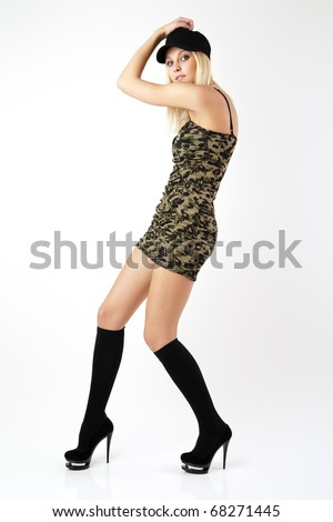The girl in a short dress of khaki color.