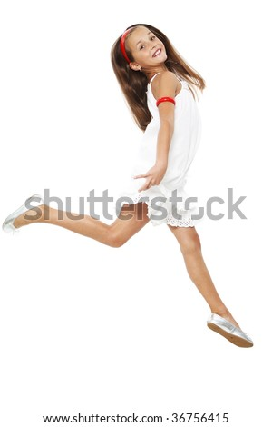 The girl in a white dress cheerfully runs