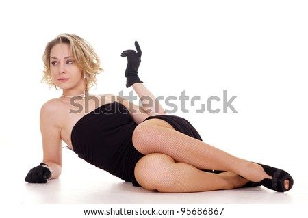 The girl in dress lying on a white background