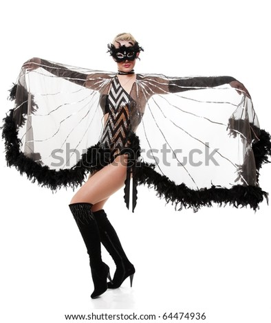 The girl in feathers and a mask in a beautiful pose