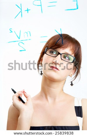 The girl in glasses thoughtfully looks at formulas