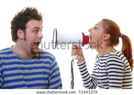 The girl in striped clothes shouts at the man in a megaphone