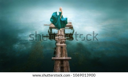 the girl in the blue dress on wooden pier