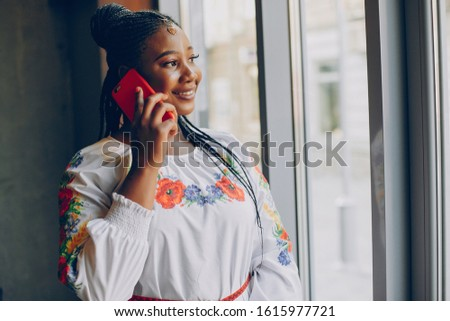 The girl in the cafe.Girl with phone.The girl looks in the window