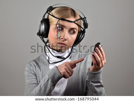 The girl in the headphones with a telephone