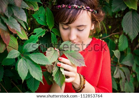 The girl in the leaves - stock photo