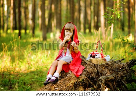 "the girl in the wood eats pies.  the fairy tale "" Red Riding Hood"""