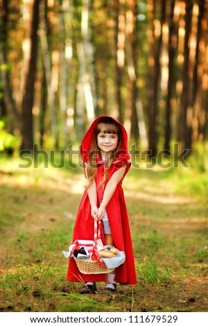 "the girl in the wood with a basket in hands.  the fairy tale "" Red Riding Hood"""