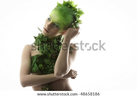 The girl in wreath of leaves - stock photo