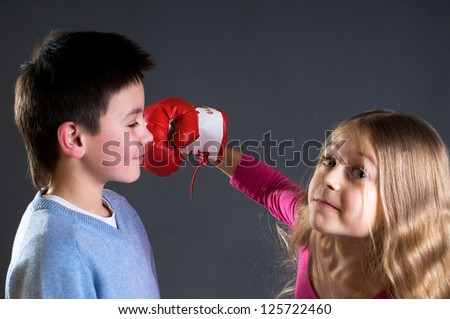 The girl is boxing boy