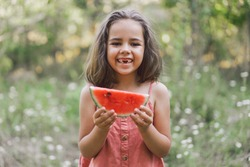 The girl is eating a watermelon. Summer mood