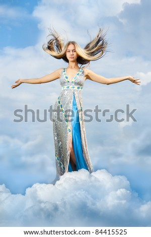 The girl is in the clouds arms outstretched