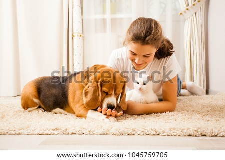 the girl is relaxing with her pets #1045759705