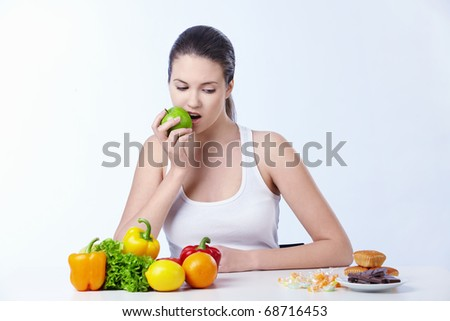 The girl is the apple and looks for dessert on a white background