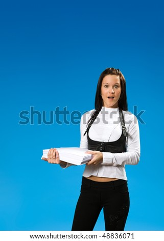 The Girl keeps papers batch on hands.