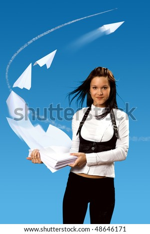 The Girl keeps papers batch on her hands. The Wind raises skyward papers and they fold up in  paper airplanes.