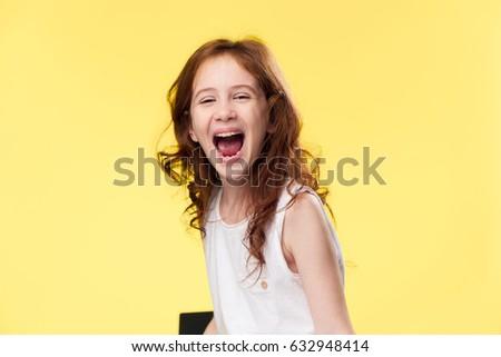 The girl laughs, the joyful girl - Shutterstock ID 632948414