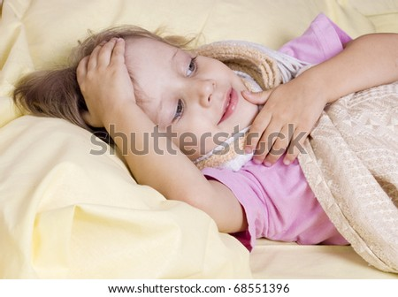 The girl lies in a bed with temperature - stock photo