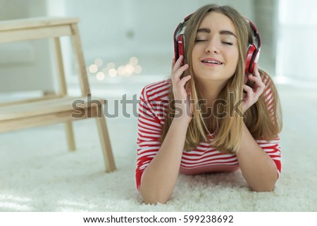 The girl listens to music #599238692