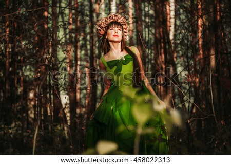 the girl looks at the sun in the forest #458022313