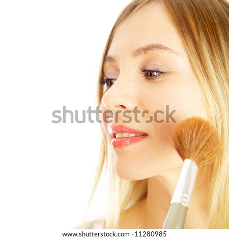 The girl on a white background. Make-up.