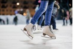 the girl on the figured skates on a opened skating rink