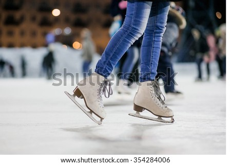 the girl on the figured skates on a opened skating rink #354284006