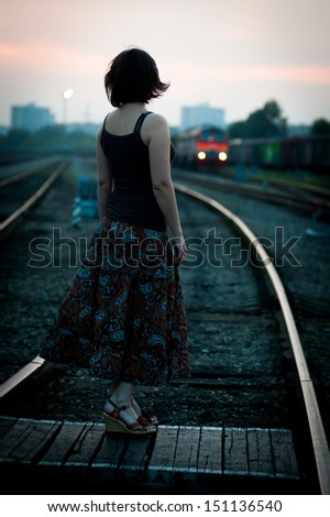 The girl on the rail waiting for the train