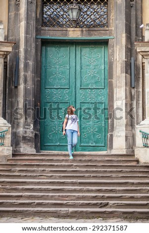 The girl on the steps of Dominican Cathedral, Lviv, Ukraine