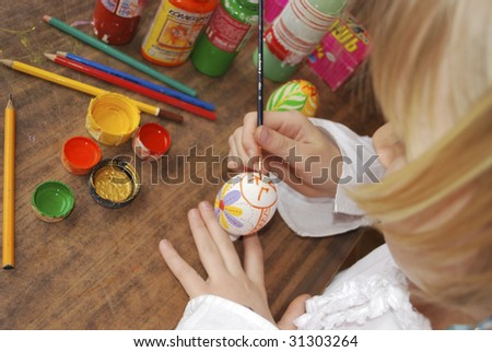 the girl painting wooden egg