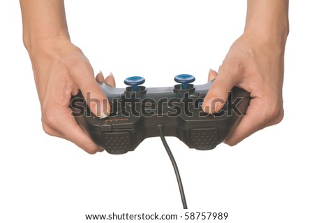 The girl plays a computer game with joypad