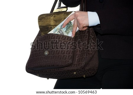 The girl puts money in a bag. Isolate on white