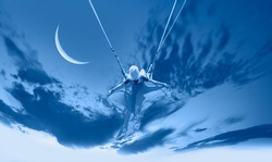 The girl riding a swing on the space on a crescent moon at night