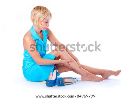 The girl's feet hurt, white background