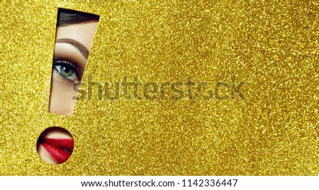 The girl says - attention A girl with beautiful puffy lips, painted in red lipstick with a metallic effect. Lips in the pit in the form of an exclamation mark of golden shiny paper.