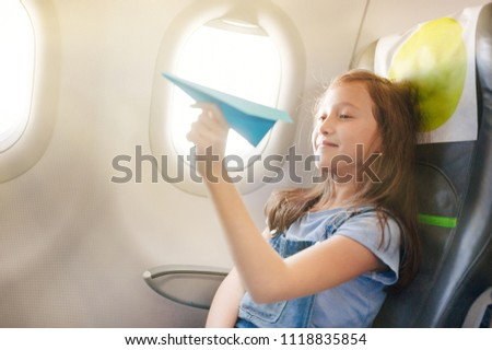 The girl sits in salon the plane on passenger sitting. #1118835854