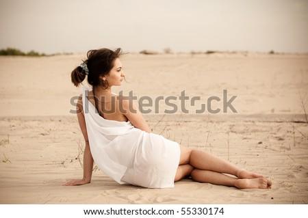 the girl sitting in the desert