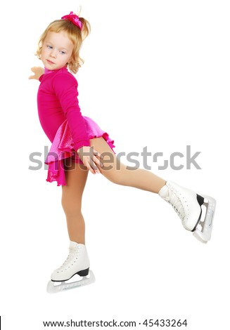 The girl skates in profile on a white background making element . Sport's  child in purple plum dress.