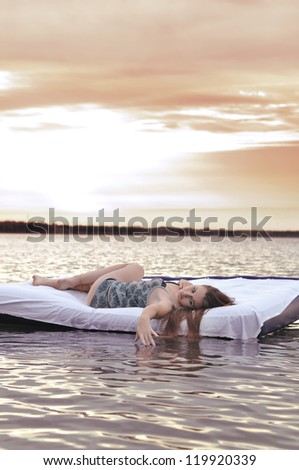 The girl slept outdoors. A bed on the lake