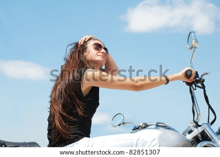 The girl that have long hair is riding motorcycle stock photo