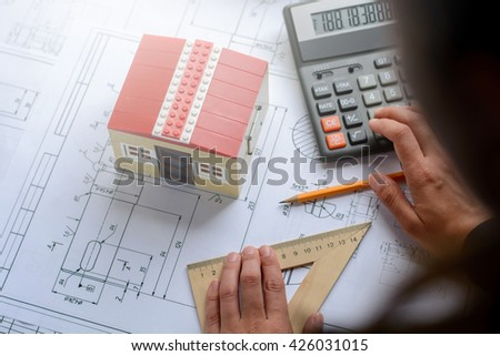 Free photos business woman makes calculations drawings diagram the girl the designer architect business woman makes calculations drawing drawings diagram malvernweather Images
