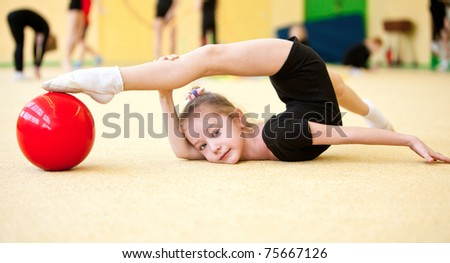 The girl the gymnast trains in a gym