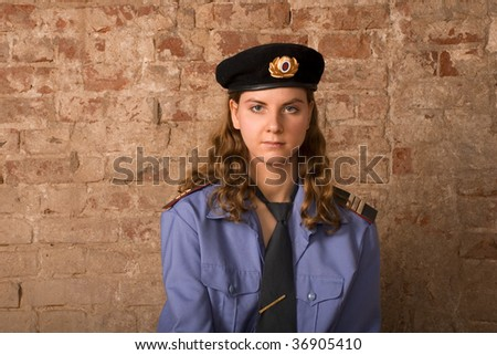 the girl the sergeant of militia against a brick wall