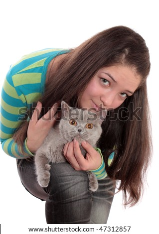 The girl the teenager and a cat on a white background, is isolated.