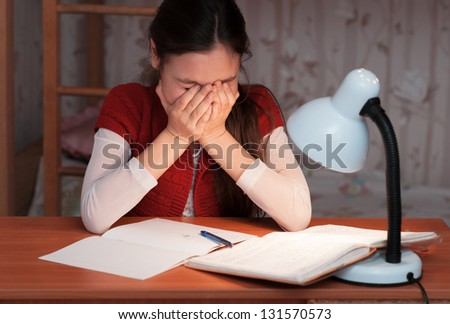 the girl was very tired to do homework