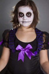 the girl wearing halloween make up