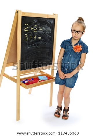 the girl wearing spectacles at a blackboard.isolated on white.